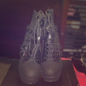 Black boots with laces in front
